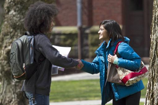The College Green: Where the world meets - Misha Carthen, left, in town from Las Vegas, introduces herself to  prospective classmate Soumitri Barua of Olean, N.Y., on the College Green. They had lots of company: Nearly a third of the 2,649 students admitted to the Class of 2017 made the trip.