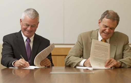 A new, stronger, strategic affiliation agreement - Dennis D. Keefe, left, president and CEO of Care New England, and Dr. Edward Wing, dean of medicine and biological sciences at Brown, signed a new affiliation agreement that strengthens ties and strategic planning among the school and Women & Infants Hospital and Butler Hospital.