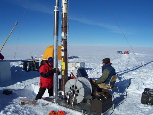 Ice Coring - Scientists extracted a 100-meter-long ice core in Greenland to measure how fossil fuel burning of industrial times has disrupted the global nitrogen cycle. At left is Meredith Hastings of Brown University, the lead author of the study, accompanied by Bella Bergeron from Ice Coring and Drilling Services.