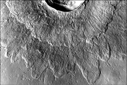 An odd type of crater - Double-layer ejecta craters could form when ejected material slides down steep crater walls and across ice, forming a top layer. Striations, common in landslides on Earth, radiate out from the crater rim.