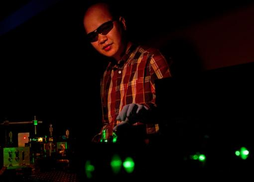 Vertical-cavity surface-emitting laser - Colloidal quantum dots — nanocrystals — can produce lasers of many colors. Cuong Dang manipulates a green beam that pumps the nanocrystals with energy, in this case producing red laser light.