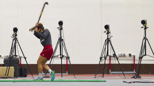 The biomechanics of a good swing - An array of four high-speed cameras records whack after whack on 11  different field hockey balls. Motion markers — bits of tape on the balls,  sticks and players' hips — documents the shot and follow-through.