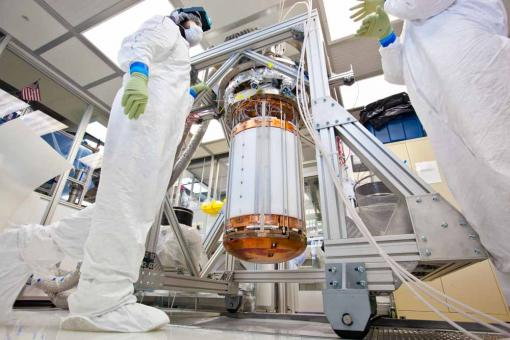How to catch a WIMP - Photomultiplier tubes capable of detecting a single photon of light line the top and bottom of the LUX dark matter detector. They will record the position and intensity of collisions between dark matter particles and xenon nuclei.