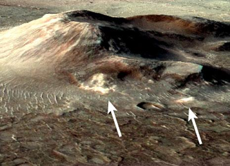 Warm, wet spots - Volcanic deposits on Mars may preserve evidence of one of the planet's most recent habitable microenvironments. The deposits, shown in white (arrows), are located in Nili Patera, a degraded volcanic cone in Syrtis Major of equatorial Mars.