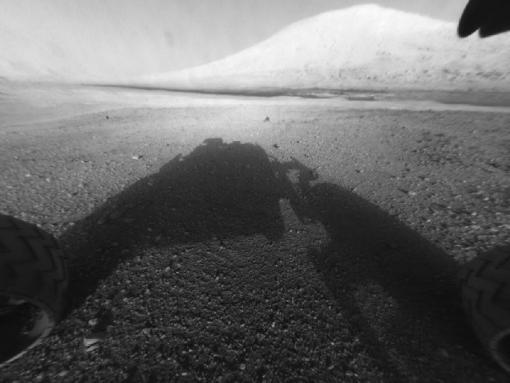 The steep road ahead - Curiosity's cameras show Mount Sharp in the distance. The rover will begin climbing the mountain in coming months, following Martian geological history as it climbs higher and examining as much as 4.5 billion years of planetary material.