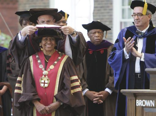 Te Doctorem Humanarum Litterarum salutamus - Chancellor Thomas J. Tisch places the doctoral hood on the shoulders of Ruth J. Simmons, 18th president of Brown University.