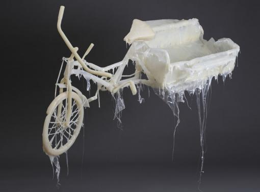 Jin Shan, My dad is Li Gang!  (2012; detail) - A lowly three-wheeled cycle, the source of livelihood for many migrant workers in Shanghai, appears to power the Chinese space station in Jin Shan's larger work at the Bell Gallery, beginning Sept. 1.