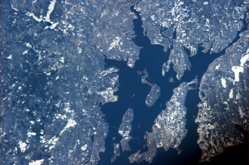 Rhode Island on a clear day - Commander Ford photographed Narragansett and Mt. Hope bays from the International Space Station. His adult kids watched him fly by from the Ladd Observatory, near the top edge of the photo, just right of center.