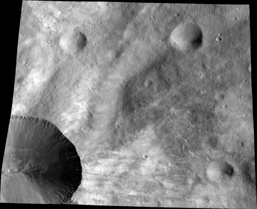 Canuleia up close - Dawn's Low Altitude Mapping Orbit (LAMO) image of the crater Canuleia illustrates the interior of the crater and complex details of the fresh rays across the soil of the asteroid Vesta.