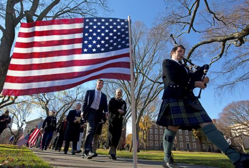 The debt we owe - Led by bagpiper Andrew Bower, the Veterans Day procession makes its way to Simmons Quadrangle from the College Green.