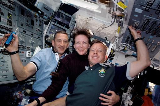 Close quarters - Atlantis astronauts happily shared the same air and small spaces, with a  multitude of surfaces, on space shuttle mission 104 in 2001. They are,  from the left, Charles O. Hobaugh, pilot; Janet L.  Kavandi, flight engineer and mission specialist; and Steven W. Lindsey,  commander.