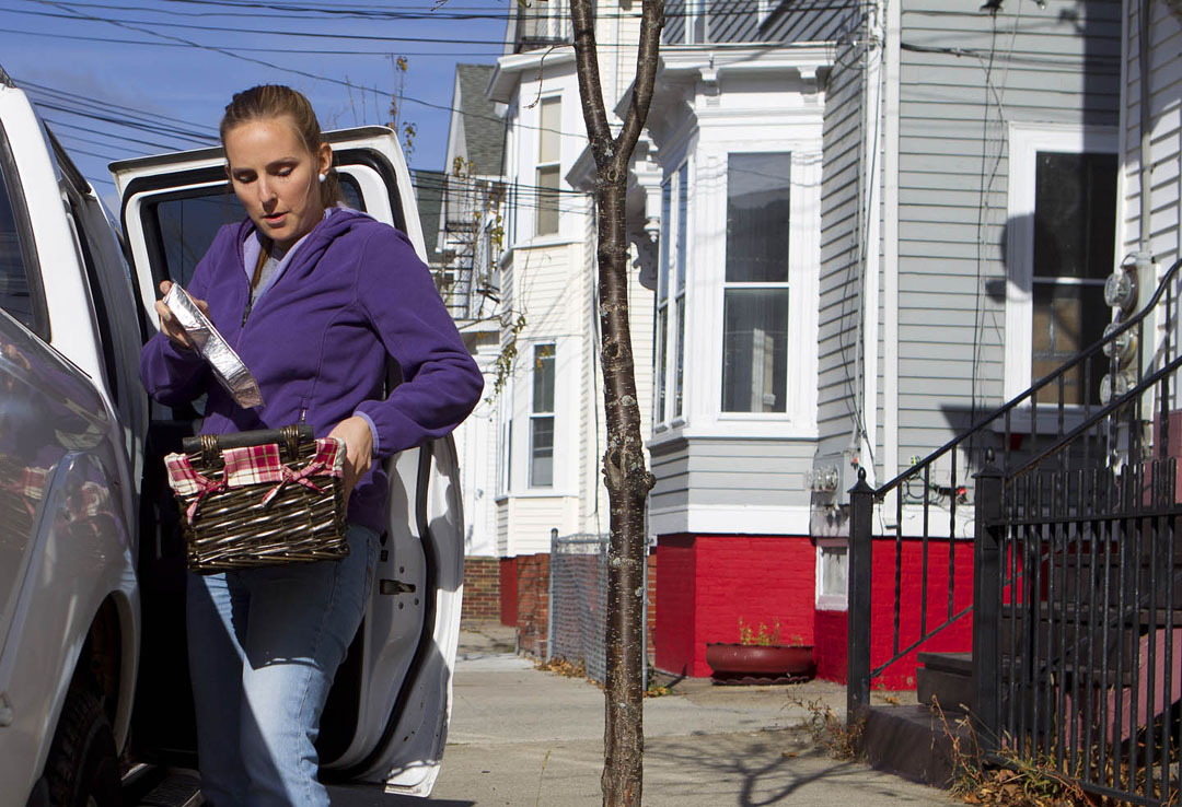 Understanding what makes and keeps a population healthy: In a widely read report, researchers Kali Thomas, a Meals on Wheels volunteer (above), and Vincent Mor found that state investment in meal delivery programs had a significant positive impact on community health. Credit: Mike Cohea/Brown University