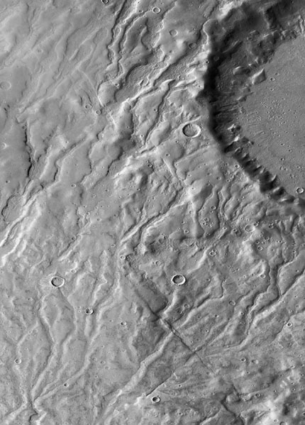 From Mars Reconnaissance Orbiter: Additional modeling might determine how fast Martian snow could have melted and whether snowmelt alone could have carved the valleys.