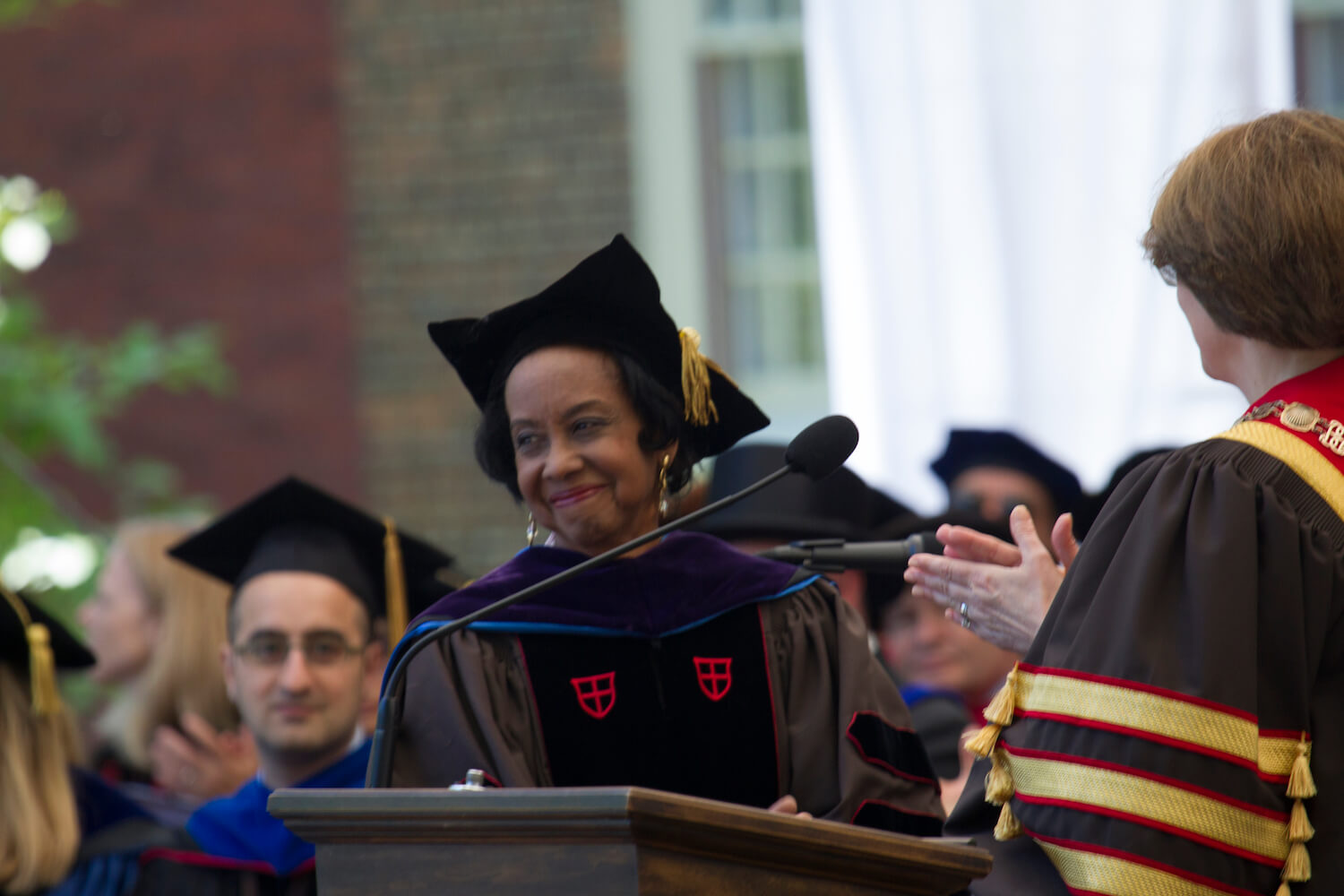 Beverly Ledbetter receives a posthumous honorary doctorate on behalf of Beatrice Coleman at Brown Commencement 2014.