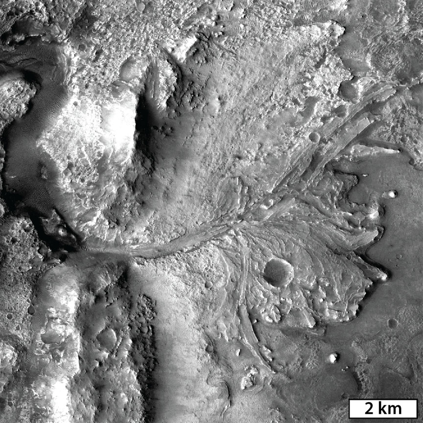 A delta-like fan at the western edge of Jezero Crater marks an area where flowing water would have entered the lake-filled crater and deposited clay minerals transported from the surrounding watershed. Image: NASA/MSSS