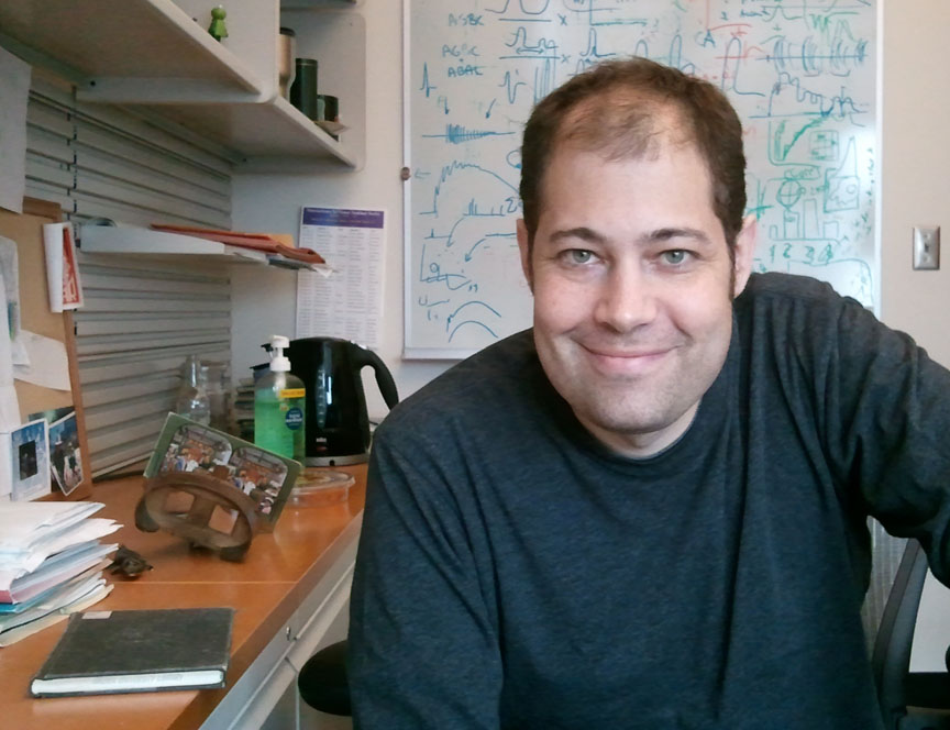 "Carlos Aizenman: In the laboratory, behavioral effects observed in tadpoles suggested a further search for a ""non-obvious but real deficit in neural function."" Credit: David Orenstein/Brown University"