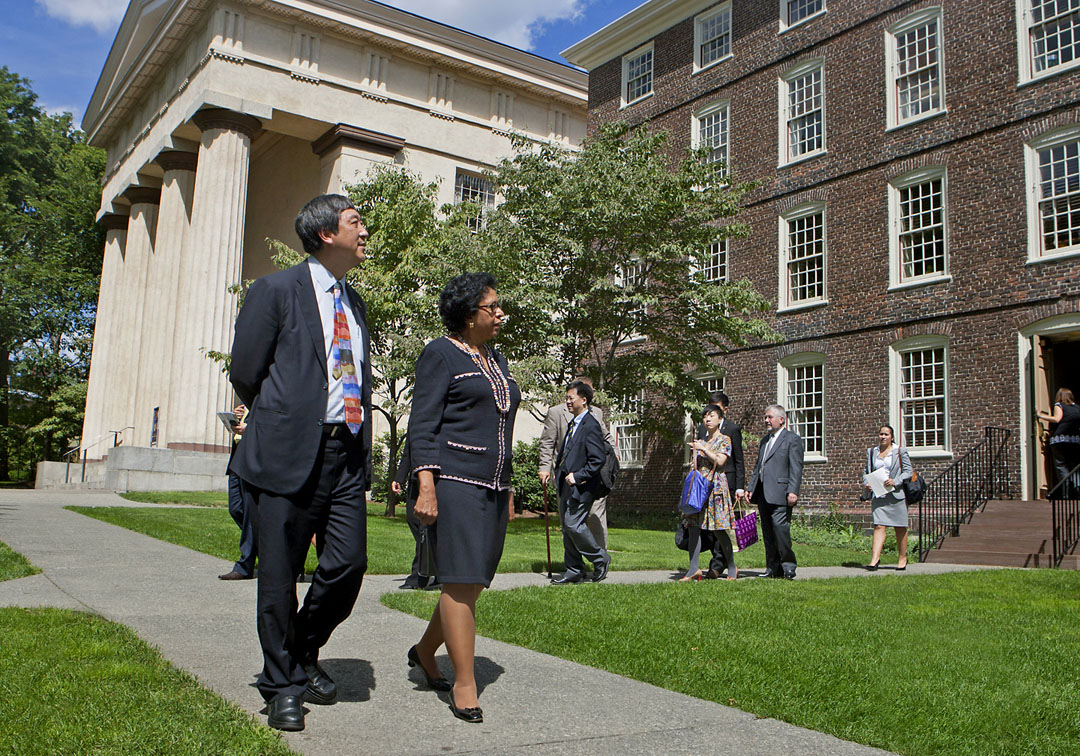 Celebrating stronger institutional ties: Presidents Simmons and Sung stroll on the Front Green after a formal signing ceremony in the President's Office. Credit: Mike Cohea/Brown University