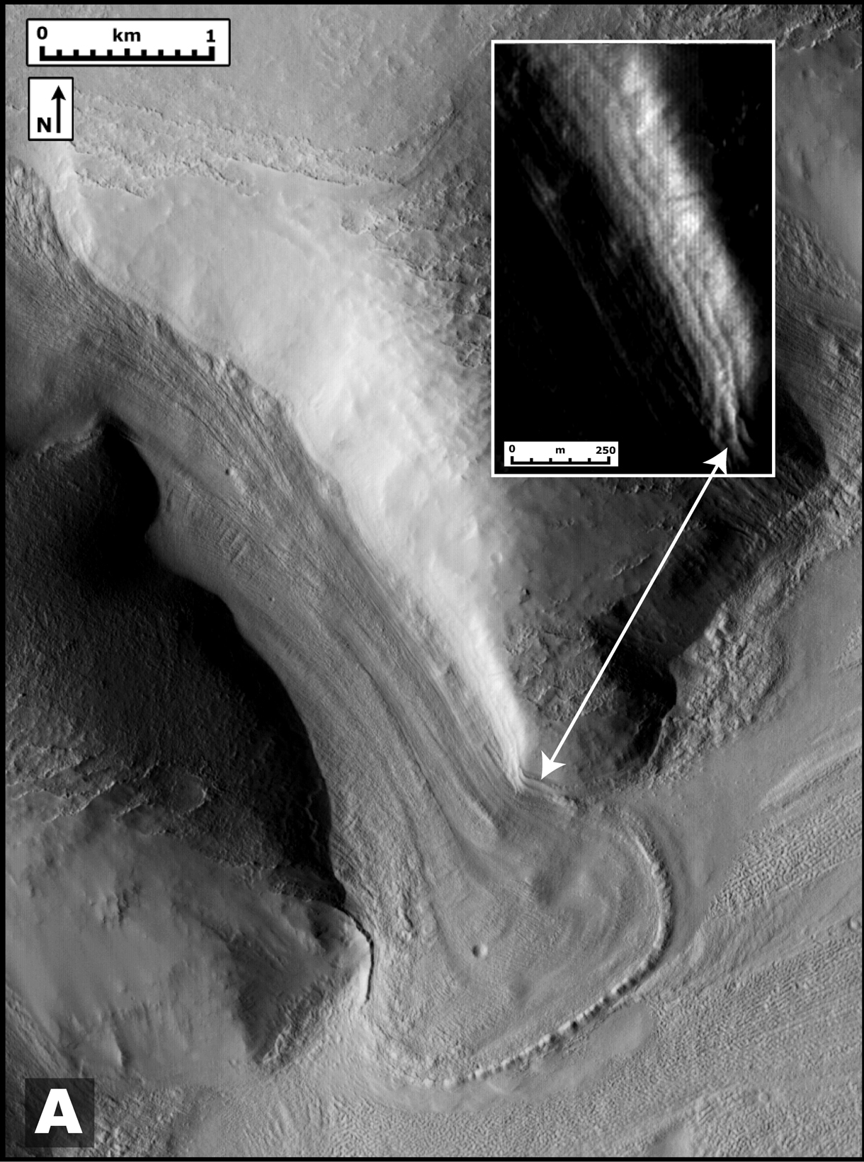 Ancient Martian Tributary: This image taken taken by the Mars Reconnaissance Orbiter shows a glacier-like lobe that had spilled from an ancient tributary on to the surrounding plain. Brown scientists report in May's issue of Geology that the lobe is superimposed on a past ice deposit and appears to be evidence of more recent glaciation.