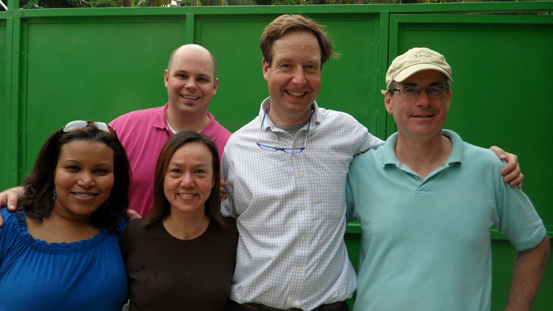 The importance of being there: Brown's physician team includes, from left, Sybil Cineas, Michael Koster, Susan Cu-Uvin, and Tim Flanigan. Patrick Moynihan, right, a Brown alumnus, is president of The Haitian Project.