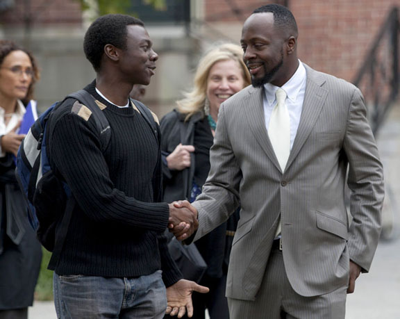 A new visiting fellow: Sophomore Bryan Maina greets Wyclef Jean on the College Green Monday. Jean accepted an appointment as visiting fellow in the Department of Africana Studies. (Download additional photos.)