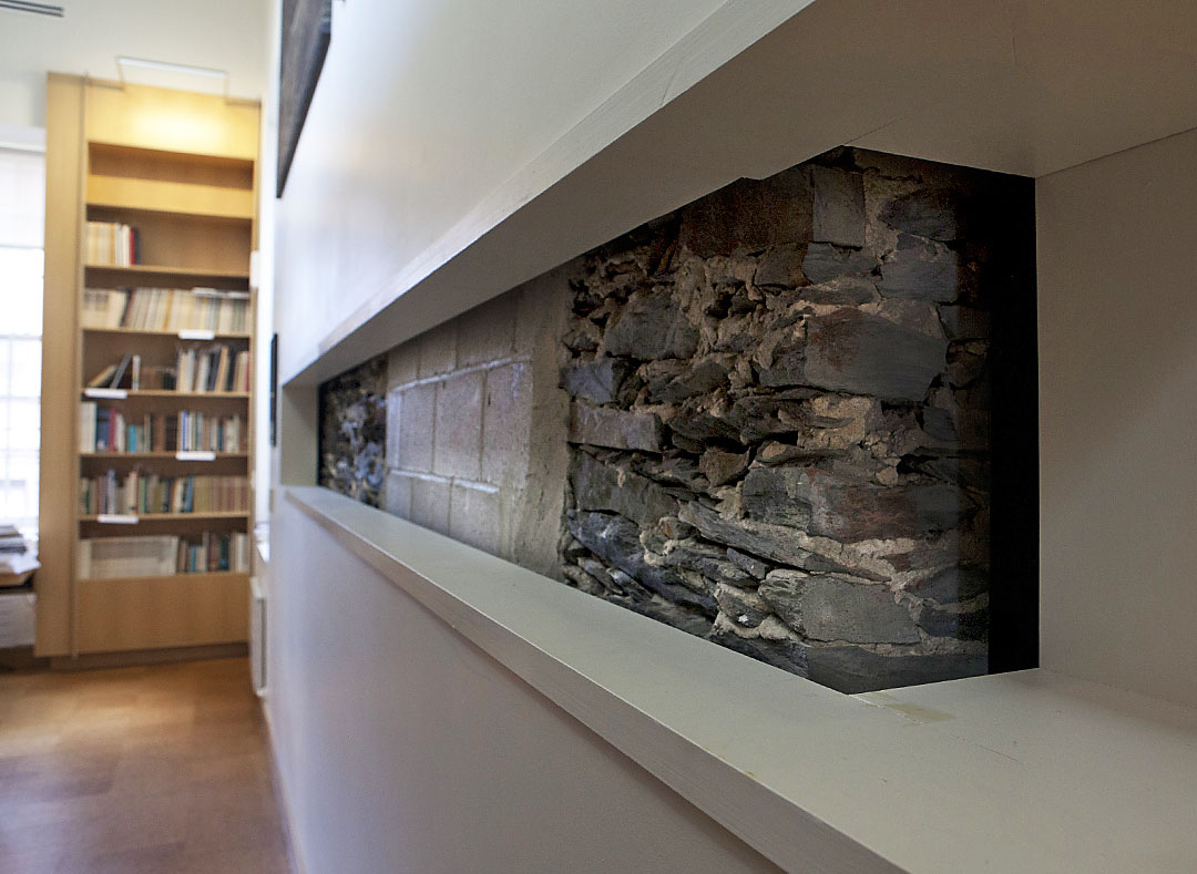 All about preservation: Architects left a portion of the original 1840 field stone wall exposed to give visitors to the Joukowsky Institute a glimpse of architectural history.