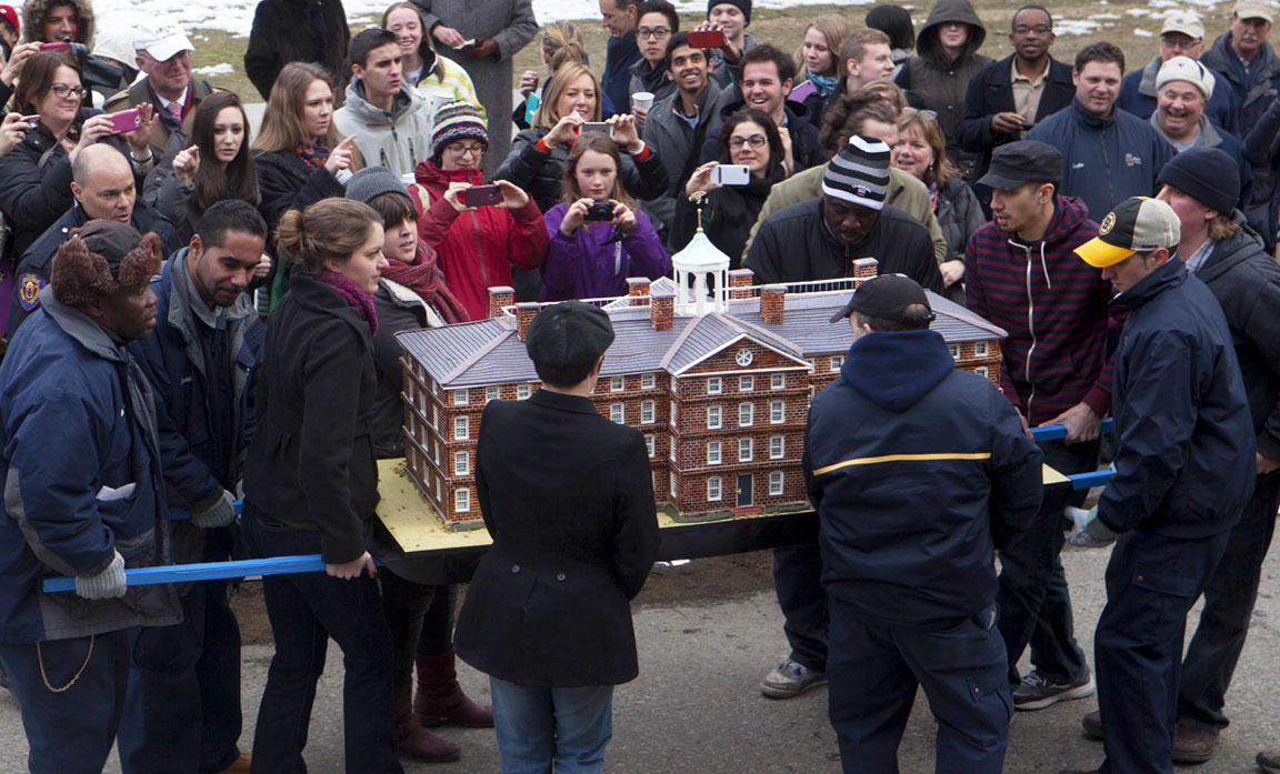 The cake arrives: The cake looked so much like a miniature University Hall, one visitor first thought it was made of foam. It was entirely edible. Thousands of slices later, it was gone.