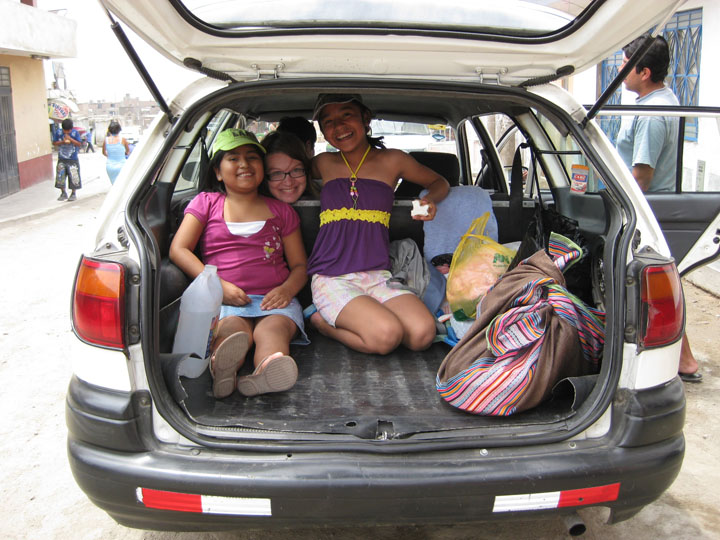 "In the field: Leinaweaver with her two God-daughters, who live in Lima. ""It's important to me to write accessibly,"" Leinaweaver has said of her work."