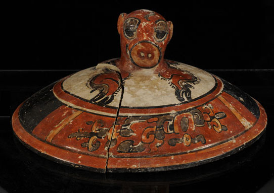 "Mayan treasure: Looking into the tomb for the first time, archaeologists saw ""an explosion of color in all directions — reds, greens, yellows. ... These items are artistic riches, extraordinarily preserved from a key time in Maya history.""  (Credit: Arturo Godoy)"