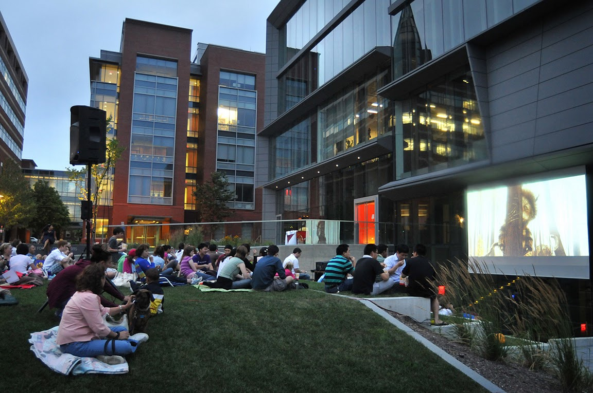 Best seats on the East Side: About 80 of the University's neighbors spread out their picnic dinners and settled in for Brown's inaugural movie night. On the big screen: Where the Wild Things Are.   Credit: Frank Mullin/Brown University