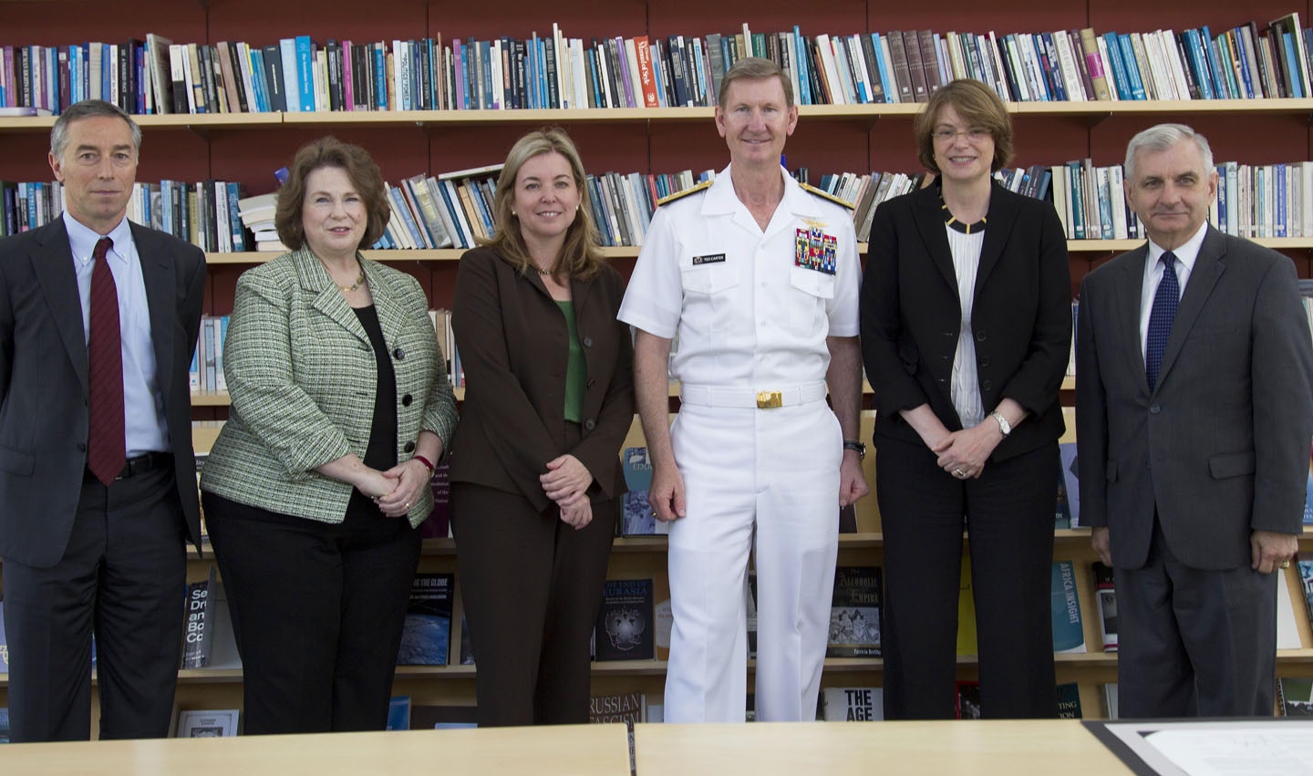 At the signing: From left, Richard Locke, Watson Institute director; Mary Ann Peters, provost of the Naval War College; Vicki Colvin, provost-elect at Brown; Rear Admiral Carter; President Paxson; Sen. Jack Reed.