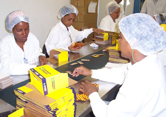 AIDS treatment in developing countries: Brazil pressed pharmaceutical companies to lower their prices and began producing AIDS medicines in public factories, as in this production line at Farmanguinhos.