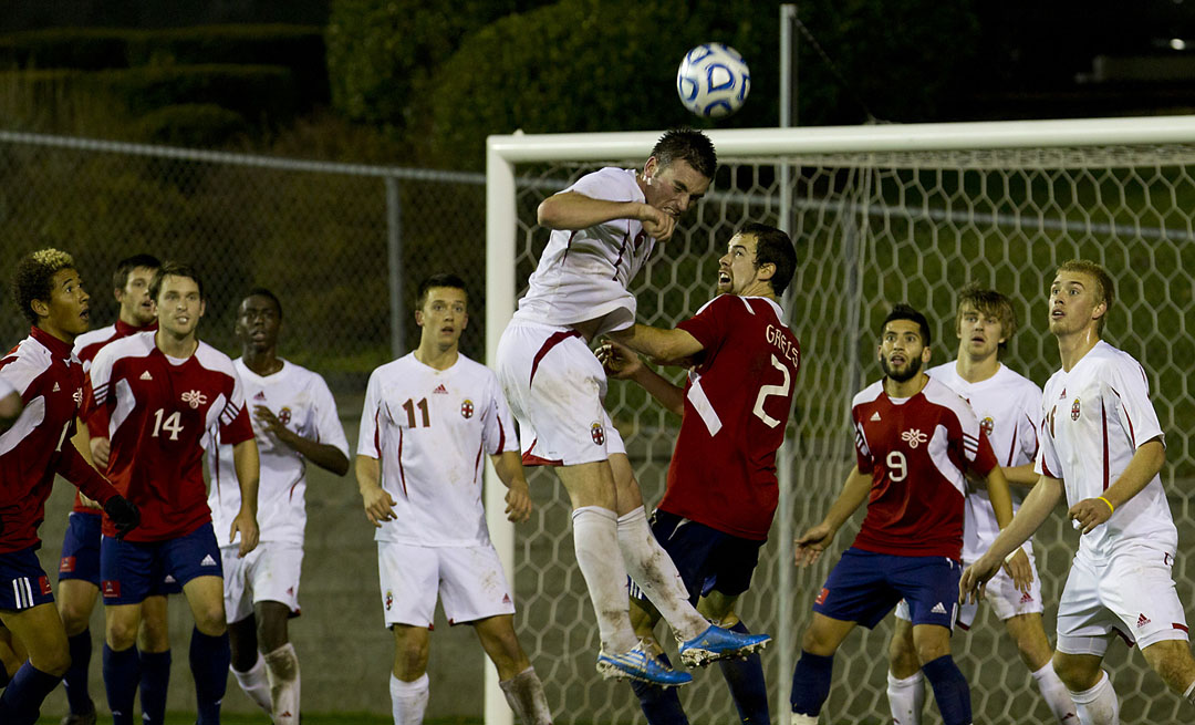 Out of harm's way: Ryan McDuff heads the ball out of trouble during a Saint Mary's corner kick.