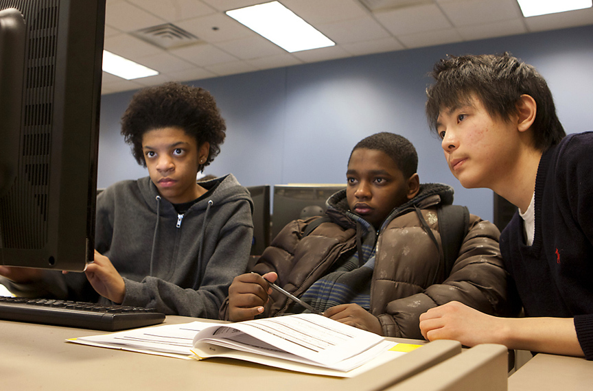 Focused on programming, unfazed by algebra: Kidai Kwon, right, works with middle-school students Devante King, left, and Wesley Cabral during an after-school Bootstrap session.   Credit: Mike Cohea